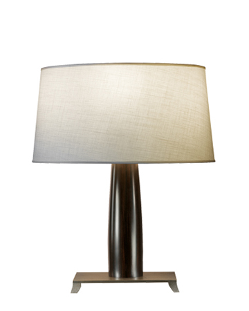 Pia is a table LED lamp with wooden structure or covered in leaher with a bronze base and hand-embroidered lampshade, from Promemoria's catalogue   Promemoria