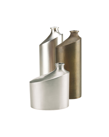 Bottiglia is a bronze or silver flower vase shaped like a bottle, from Promemoria's catalogue | Promemoria