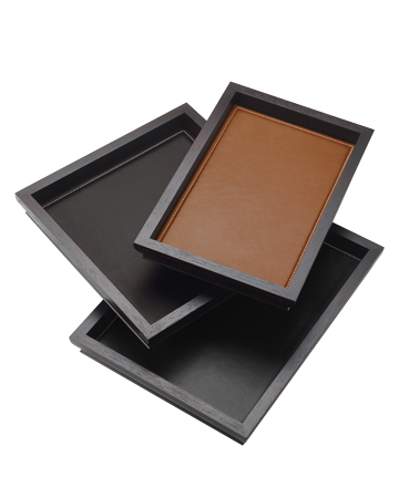 Ambrogio is a wooden tray with a leather placemat from Promemoria's catalogue | Promemoria
