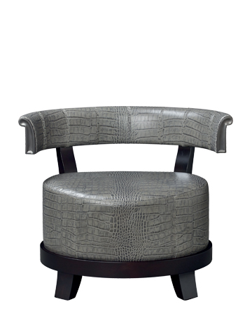 Chelsea is a wooden armchair covered in fabric or leather with bronze details, from Promemoria's catalogue | Promemoria