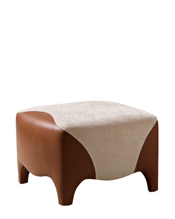 Club is a pouf covered in fabric and leather, from Promemoria's catalogue | Promemoria