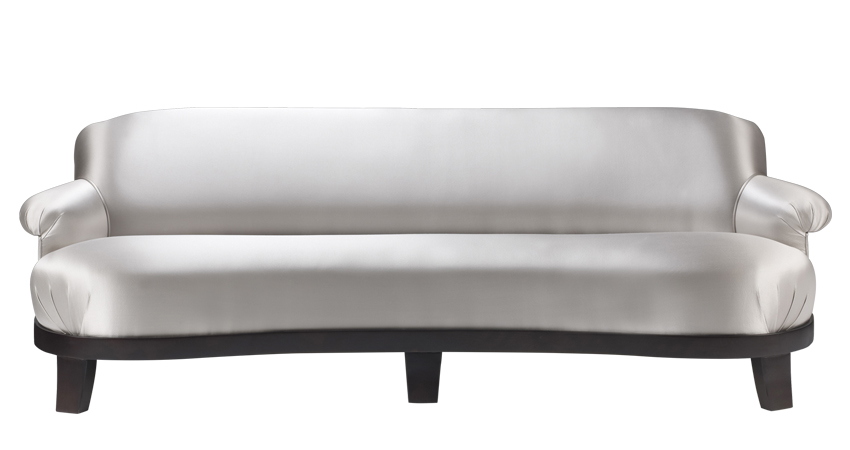 Gacy is a wooden sofa covered in fabric or leather, from Promemoria's catalogue | Promemoria